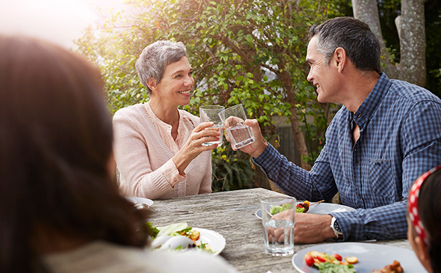 couple-at-table-outdoors-at-dinner-party-supporting-bladder-health