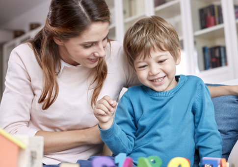mother-and-son-playing-with-toys_485x342